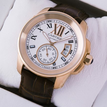 Calibre de Cartier pink gold mens watch W7100009 silver dial brown leather strap