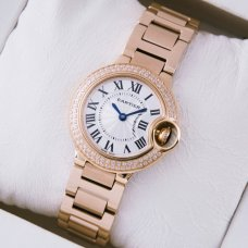 Ballon Bleu de Cartier small swiss quartz pink gold watch with diamond bezel